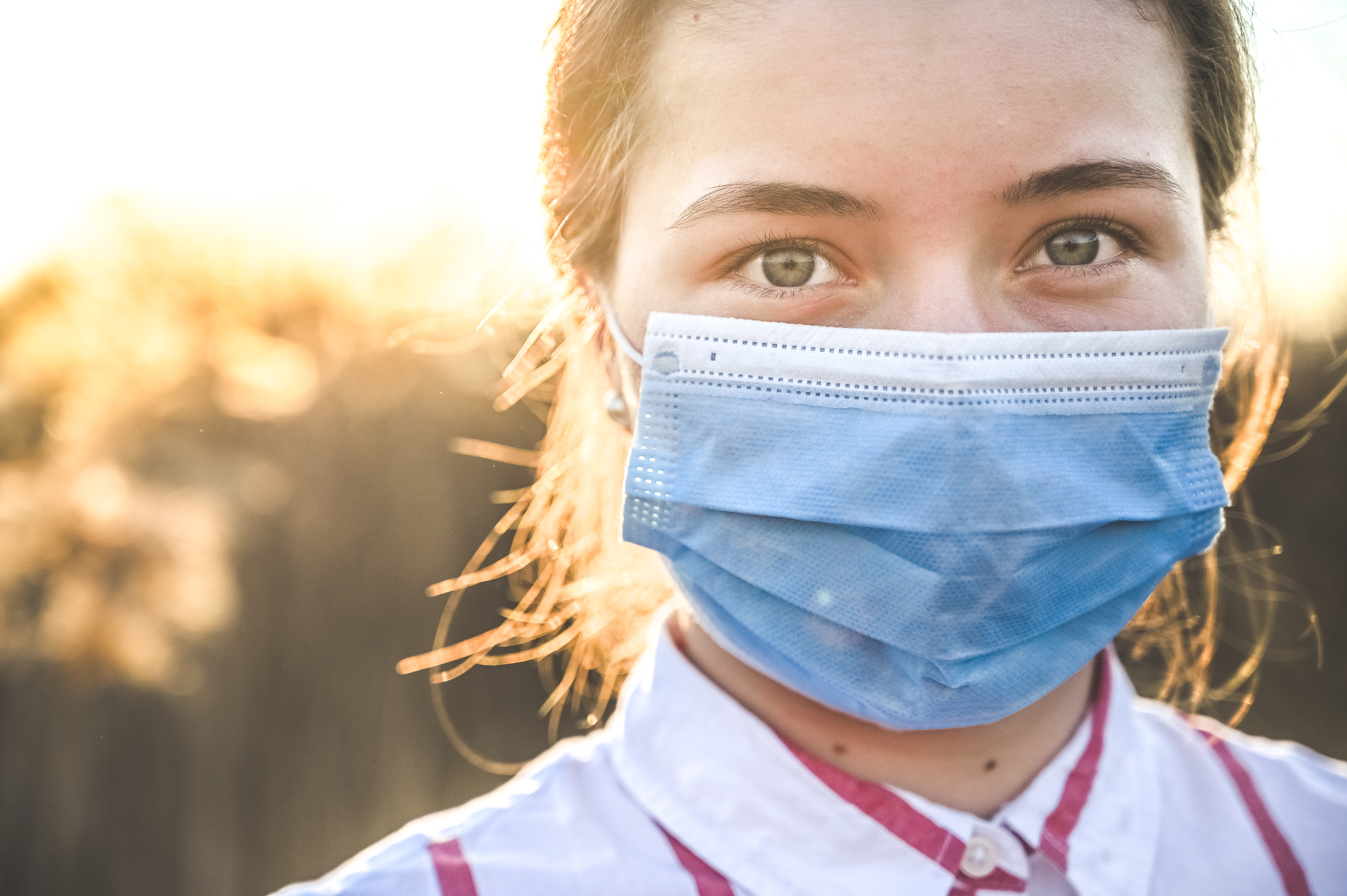 Woman wearing protective mask against coronavirus. Put mask to fight against Corona virus. COVID-19 SARS, SARS-CoV, virus 2020 chinese virus 2019-nCoV
